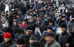 Muslim migrant workers leave prayers on the first day of the Muslim holiday Eid al-Adha in Moscow